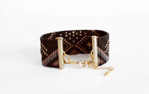 Attache bracelet manchette tissé tons noir doré et chaine boule apprêt doré à l'or fin